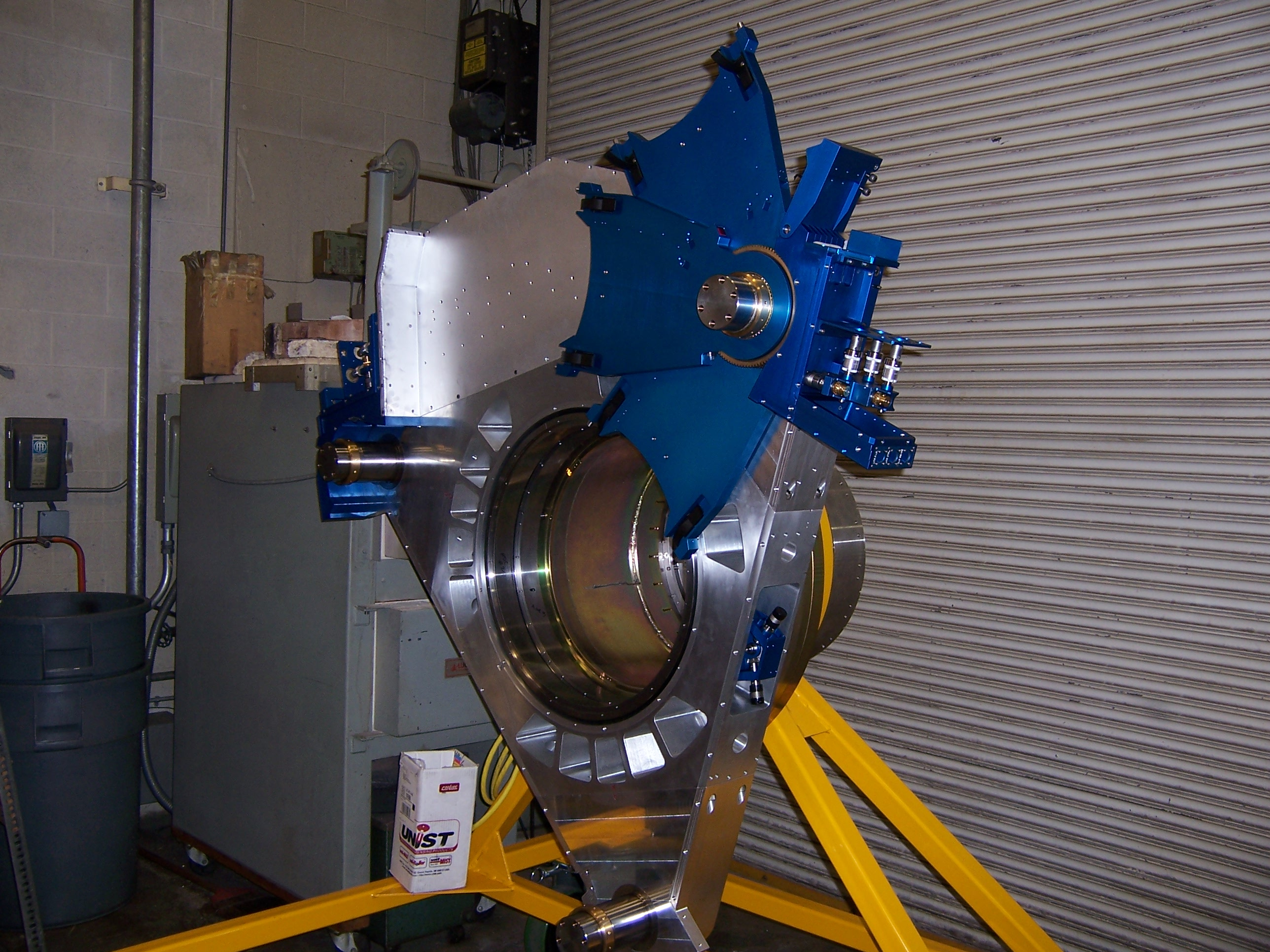 Parts of the ODI instrument support package are put together for the first time. The blue-painted components are part of the fitler mechanism.