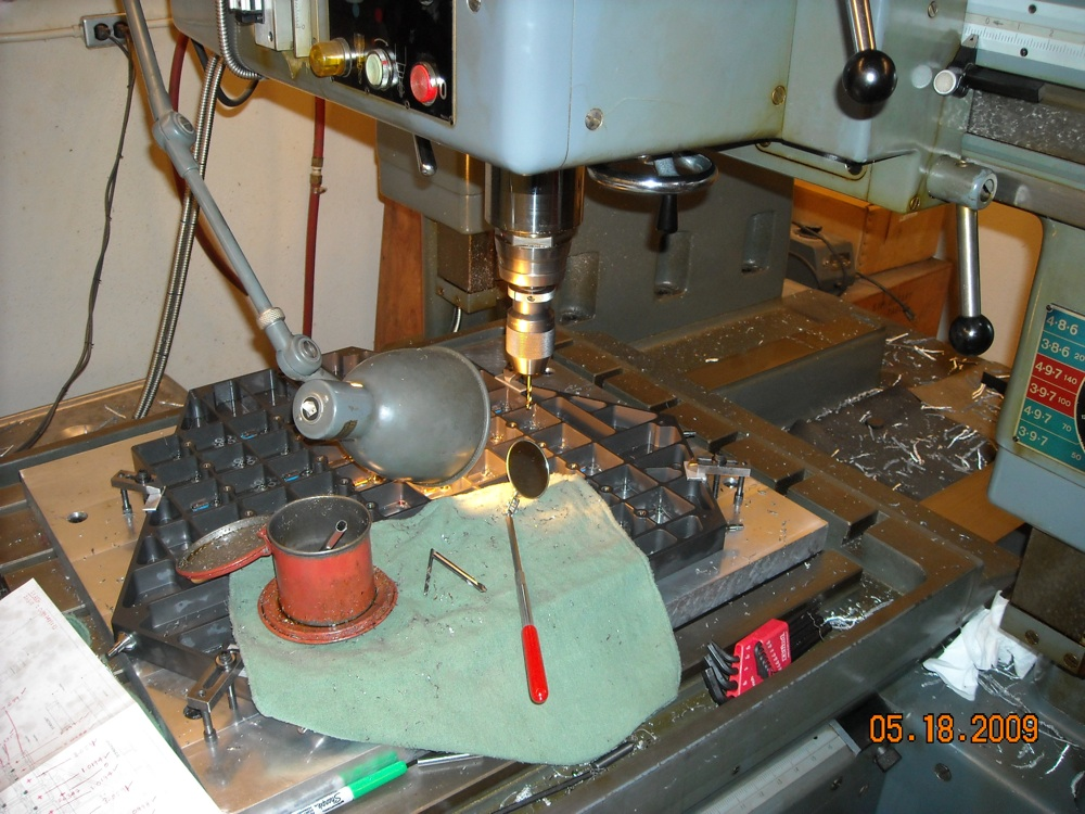 Drilling of precisely located holes in the focal plate